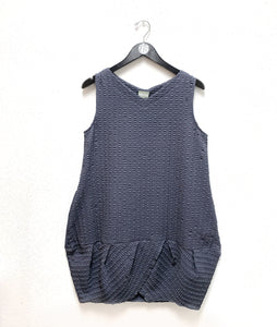 grey sleeveless tunic with a vneck and a pleated bottom