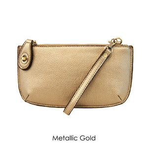metallic gold leather clutch on a white background