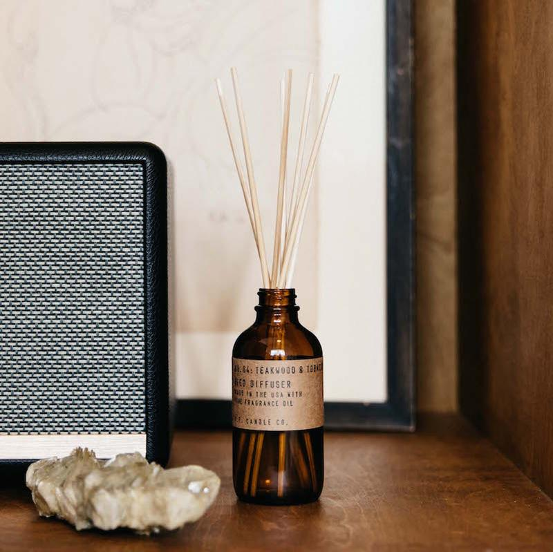 reed diffuser in an amber bottle
