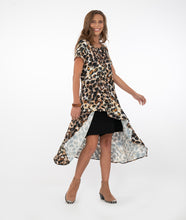 Load image into Gallery viewer, model in an animal print button up with black shorts in front of a white background