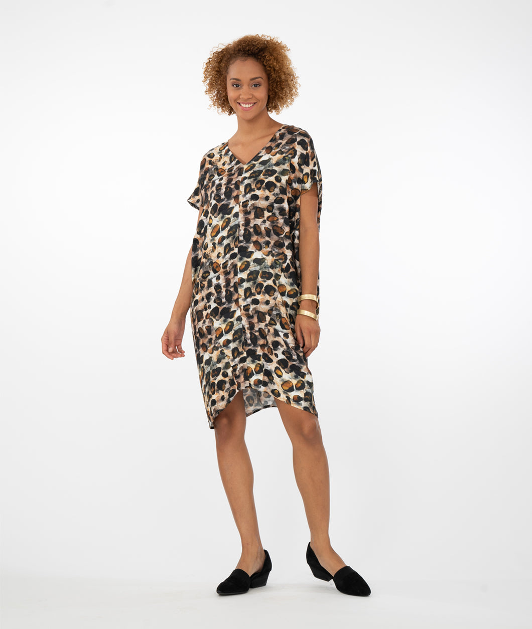 model wearing an animal print dress in front of a white background