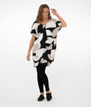 Load image into Gallery viewer, brunette model in a tan/black/white tunic with black leggings in front of a white background