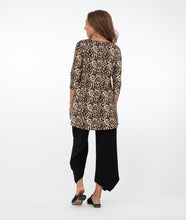 Load image into Gallery viewer, brunette model in a safari print top with black pants in front of a white background