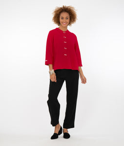 model in black pants and a red button down blouse with 3/4 sleeves and twin horizontal buttons.