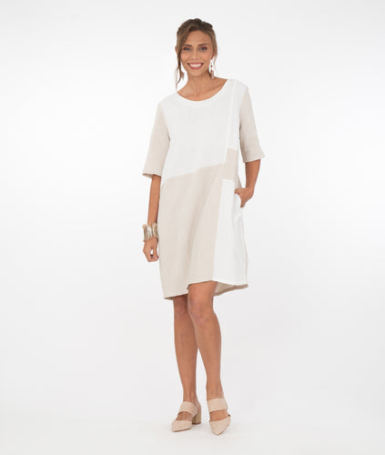 model in a white and beige color blocked knee length dress