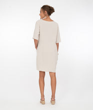 Load image into Gallery viewer, model in a white and beige color blocked knee length dress