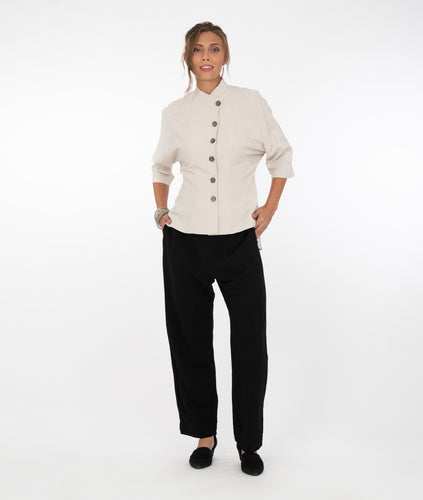 model in a bone color button down blouse with a dolman style sleeve, princess seams and a short standing collar