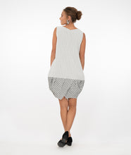 Load image into Gallery viewer, brunette model wearing a black and white checked tunic and pockets in front of a white background