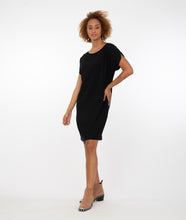 Load image into Gallery viewer, model in a black shift dress with a split cap sleeve