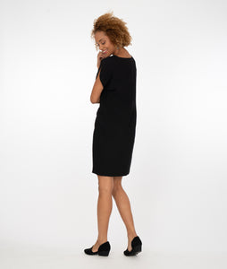 model in a black shift dress with a split cap sleeve