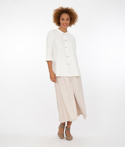 model with a white button up shirt with a khaki pant in front of a white back ground
