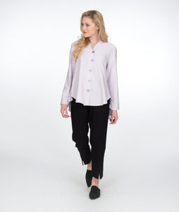 model in a slim black pant with a lilac button up blouse with a high low hem and a small standing collar