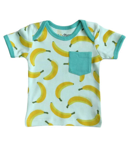 Pictured is a blue baby tee with yellow bananas printed on it against a white background