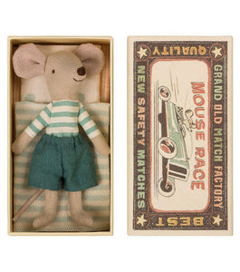"Pictured is a package disguised to look like a match box that says ""Mouse race"" on it with a drawing of a mouse racing a car. On the left side of the photo, there is a small stuffed mouse laying on a little bed. Pictured in front of a white background."