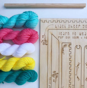 bundles of yarn with a wooden spool kit