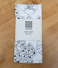 Load image into Gallery viewer, black and white floral print dish towel, folded in its packaging on a wood background