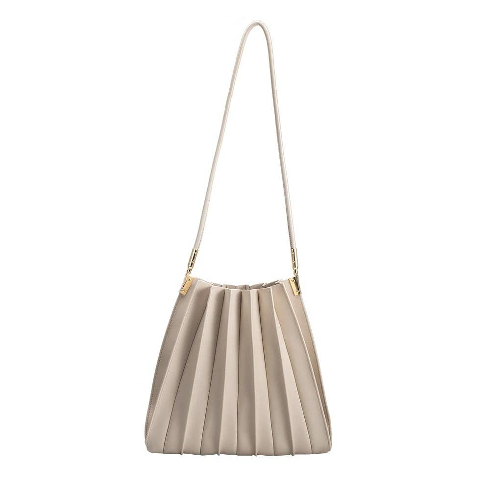 bone color handbag with a long strap and a pleated detail