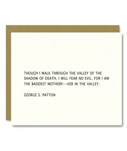 Pictured against a white background is a white card with text quoting George S. Patton that says,