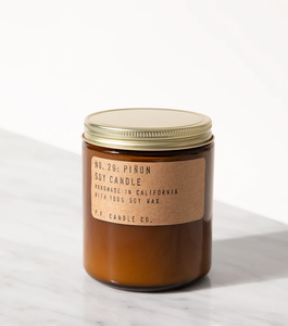 soy candle in a brown jar with a gold tinted lid on a white background