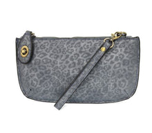Load image into Gallery viewer, Pictured against a white background is a chambray colored crossbody wristlet with subtle leopard print throughout. The clutch features gold hardware and a small gold clasp at the top left hand corner.