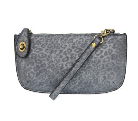Pictured against a white background is a chambray colored crossbody wristlet with subtle leopard print throughout. The clutch features gold hardware and a small gold clasp at the top left hand corner.