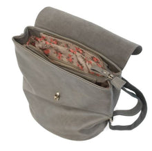 Load image into Gallery viewer, Interior view of the pleather, charcoal colored backpack opened. The interior features a gold zipper, floral linen lining, and a small interior pocket.