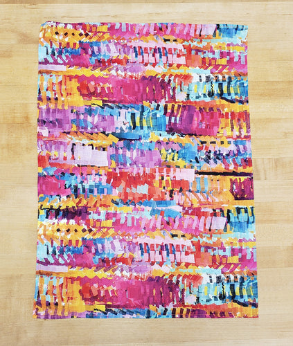 multicolor dish towel on a wooden background