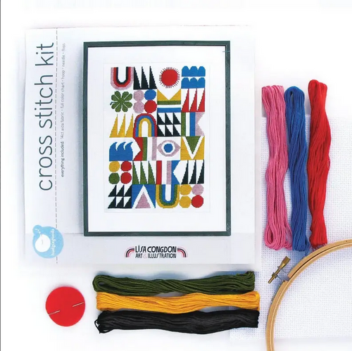 cross stitch set with threads, hoop, needle, and image of art