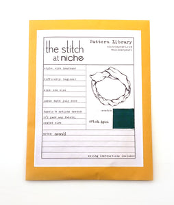 sewing pattern envelope for a wired headband, with a fabric swatch in emerald green silk