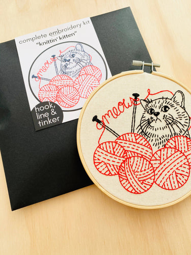 envelope and embrodery hoop with a kitten and yarn design