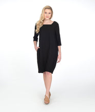 Load image into Gallery viewer, model in a black shift dress with 3/4 sleeves and a squared neckline