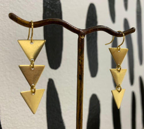 Pair of brass earrings with 3 brass triangles.