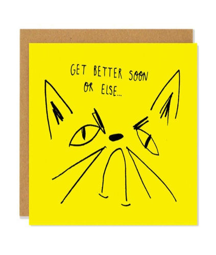 Pictured against a white background is a brown envelope with a yellow card on it. The card has a line drawn illustration of a cat frowning with the handwritten text,