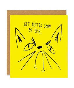 "Pictured against a white background is a brown envelope with a yellow card on it. The card has a line drawn illustration of a cat frowning with the handwritten text, ""get better soon or else..."" over it"