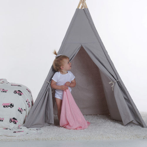 small child standing in a small play tent