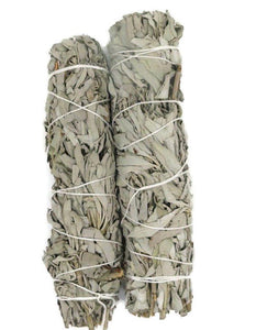 two large bundles of white sage, wrapped in white twine