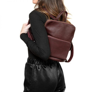 model with a wine color backpack