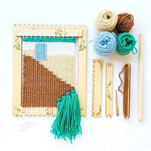 Load image into Gallery viewer, multicolored yarn bundles and a a design woven on a wooden loom with wooden tools