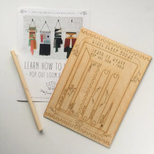 Load image into Gallery viewer, image of a wooden loom kit with an instruction booklet