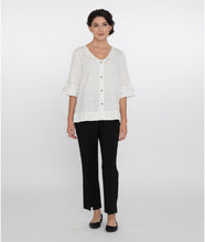 Load image into Gallery viewer, model in a white top with black pants in front of a white background