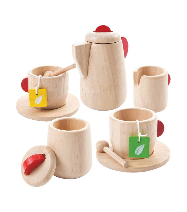 Wooden tea set with two cups and saucers, wooden milk saucer, wooden sugar container, and wooden tea kettle.