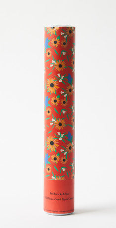 Pictured against a white background is a red cylinder tube with floral print on it.