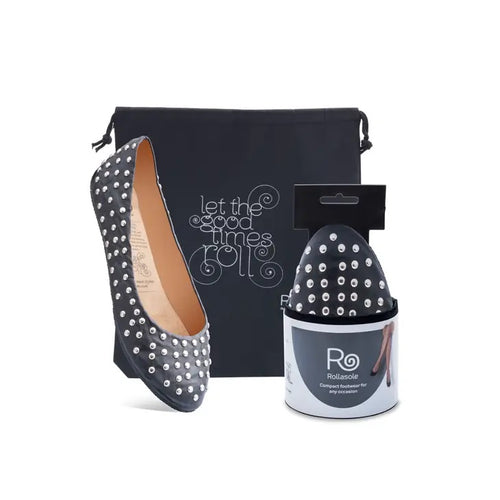 studded black ballet flat with a carrying case and the mate shoe in compact packaging