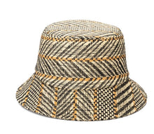 Load image into Gallery viewer, Photo of black, white, and tan straw bucket hat against a white background.