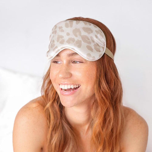 model in a leopard print eye mask