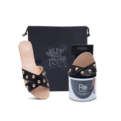 black sandle with gold studs, with a carrying case and the mate shoe in compact packaging