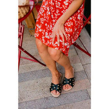 Load image into Gallery viewer, model in a red print dress with black and gold sandles
