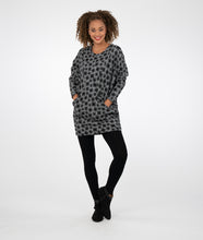Load image into Gallery viewer, model in a grey tunic with black square print and pockets at the hip