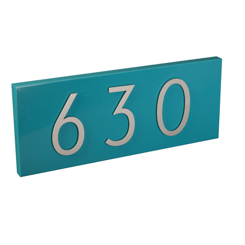 turquoise address plaque with silver numbers