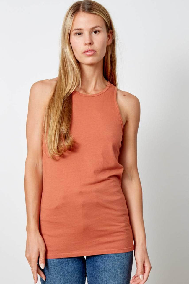 womens racerback tank top in burnt orange. Has a high neckline and runs long